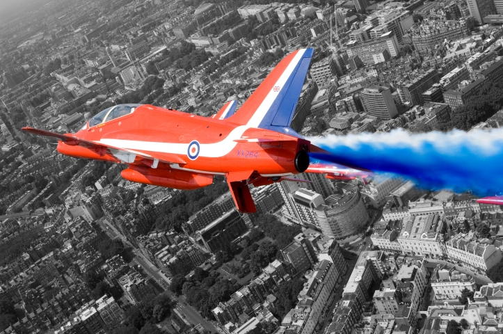 A Hawk T1A from the Red Arrows roars over London during a flypast for the Queen's 80th Birthday