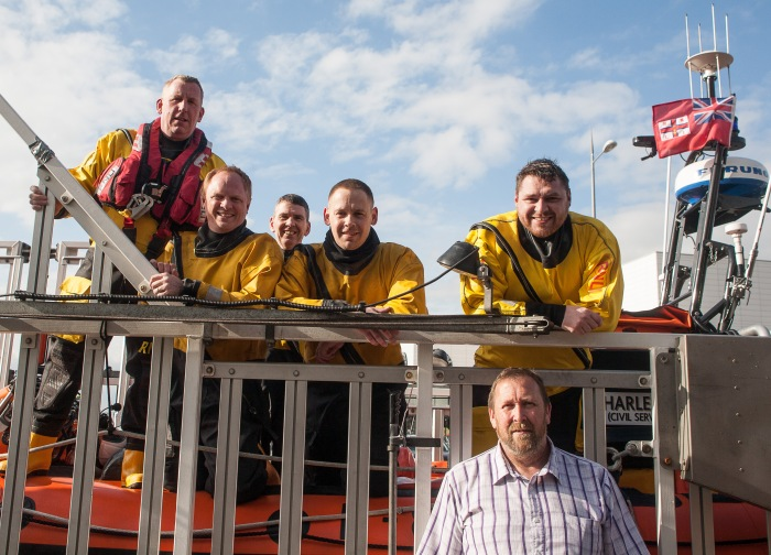 Rescue crew on return to lifeboat station. CREDIT: RNLI/BOB WARWICK