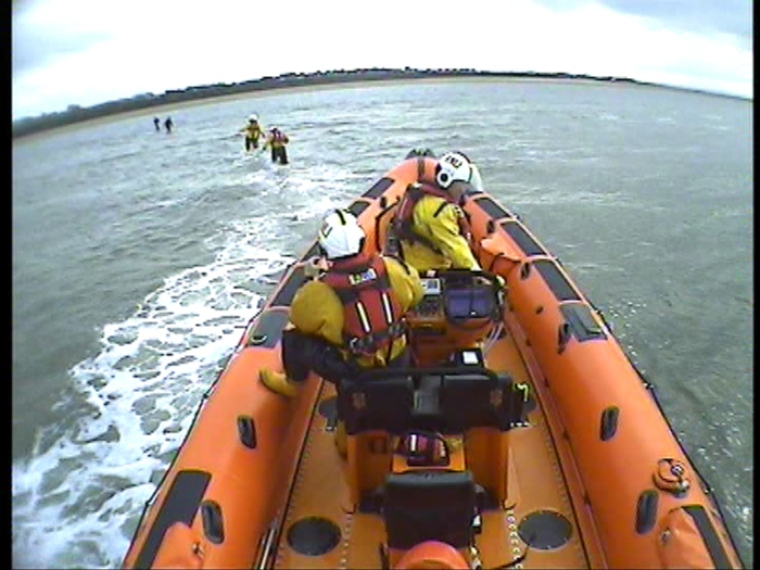 Crewmen Matt Gill and Matt Fossett wade out to casualties. CREDIT: RNLI?BOB WARWICK