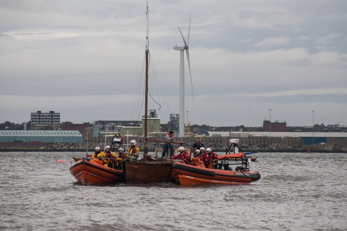New Brighton and Southport lifeboats with yacht Credit: RNLI/Bob Warwick