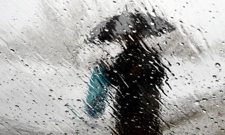 A man with an umbrella in the rain