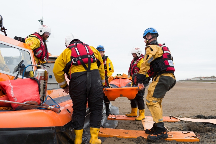 volunteers_from_rnli_hoylake_lifeboat_station_rescue_a_man_stuck_in_the_mud