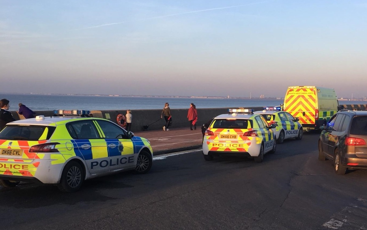 Woman trapped in mud rescued and police enter the water to save man in TWO separate incidents in New Brighton